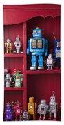 Toy Robots On Shelf  Beach Towel by Garry Gay