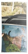 Travelling Tourist With Map Of Tasmania Beach Towel