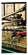Two Red Wrenches On Plumber's Workbench Beach Towel
