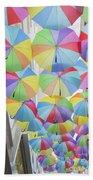 Under Umbrellas Beach Towel