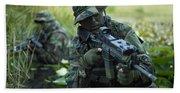U.s. Navy Seals Cross Through A Stream Beach Towel