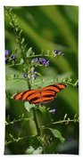Vibrant Oak Tiger Butterfly Surrounded By Blue Flowers Beach Towel