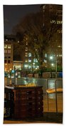 View Of Chess Board In The Middle Of Busy Sidewalk At Night Beach Towel