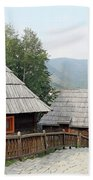 Village With Wooden Cabin Log On Mountain Beach Towel