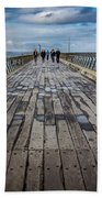 Walking The Pier Beach Towel