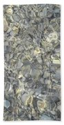 Wave Over Shells  Beach Towel