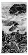 Waves Against A Rocky Shore In Bw Beach Towel by Doug Camara