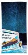 Welcome Sign To Death Valley National Park California At Night Beach Towel