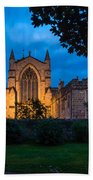 West Side Of Hexham Abbey At Night Beach Towel