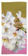 White Cherry Blossoms Against A Pink And Gold Background Beach Towel