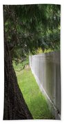 White Fence And Tree Beach Towel by Tom Singleton