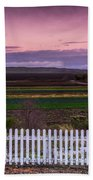 White Picket Fence Looking Over Farmland  Beach Towel