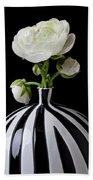 White Ranunculus In Black And White Vase Beach Towel