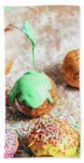 Woman's Hand Coating A Donut With Green Frosting. Beach Towel