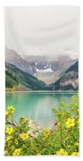 Yellow Flowers At Lake Louise Beach Towel