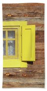 Yellow Window On Wooden Hut Wall Beach Towel