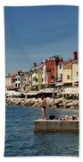 Young Couple Fishing Reading Sunbathing On Dock At Piran Sloveni Beach Towel