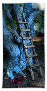 Young Woman Climbing A Tree Beach Towel