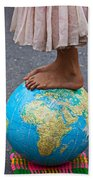 Young Woman Standing On Globe Beach Towel by Garry Gay