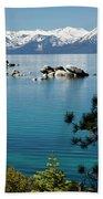Rocks In A Lake With Mountain Range Beach Sheet