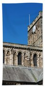 architecture of Hexham cathedral and clock tower Beach Towel