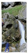 Climbers Making Their Way Up The Cliffs Of Gordale Scar Beach Towel