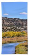 Distant Boat On The San Juan River In Fall Beach Towel