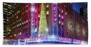 Holiday Season At Radio City Music Hall  Beach Towel