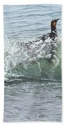 King Penguins Swimming In The Waves Beach Towel by Alan M Hunt