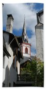 old historic church spire and houses in Ediger Germany Beach Towel