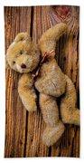 Old Teddy Bear Hanging On The Door Beach Towel