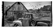 Old Truck At The Barn Bordered Black And White Beach Towel