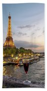 Portrait View Of The Eiffel Tower At Night With Wine Glass In The Foreground Beach Sheet
