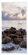 Rocky Beach At Sunset Beach Towel by Brian Jannsen