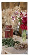Rustic Wooden Table With Various Herbs And Flowers Beach Towel
