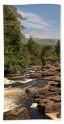 The Falls Of Dochart And Bridge At Killin In Scottish Highlands Beach Towel