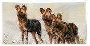 Three African Wild Dogs Beach Towel