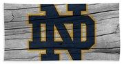 University Of Notre Dame Fighting Irish Logo On Rustic Wood Beach Sheet