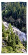 Waterfall In The Mountains. Beach Towel