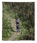 2 Photographers Walking Through Tall Grass Fleece Blanket
