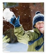 A Boy Throws A Snowball While Playing Fleece Blanket