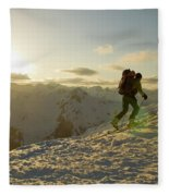 A Man Backcountry Skiing At Sunset Fleece Blanket