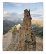 A Man Tops Out A Spire On Treasure Fleece Blanket