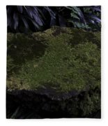 A Moss Covered Stone Inside The National Orchid Garden In Singapore Fleece Blanket