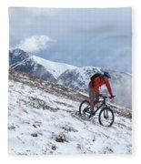 A Mountain Biker Rides Through The Snow Fleece Blanket