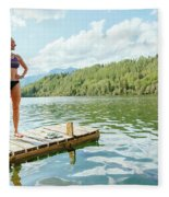 A Woman Is Standing On A Jetty Fleece Blanket