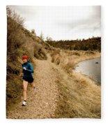 A Woman Jogging On A Dirt Trail Fleece Blanket