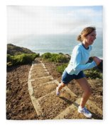 A Woman Running Stairs Near The Ocean Fleece Blanket