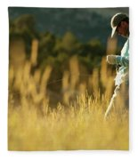 A Young Man Fly-fishing At Sunset Fleece Blanket