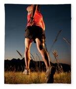 A Young Woman Runs Through A Grassy Fleece Blanket